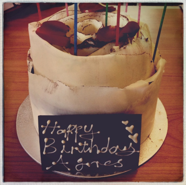 It is a birthday cake! White chocolate on the outside and a dark chocolate label with Happy Birthday Agnes written on it with white chocolate.