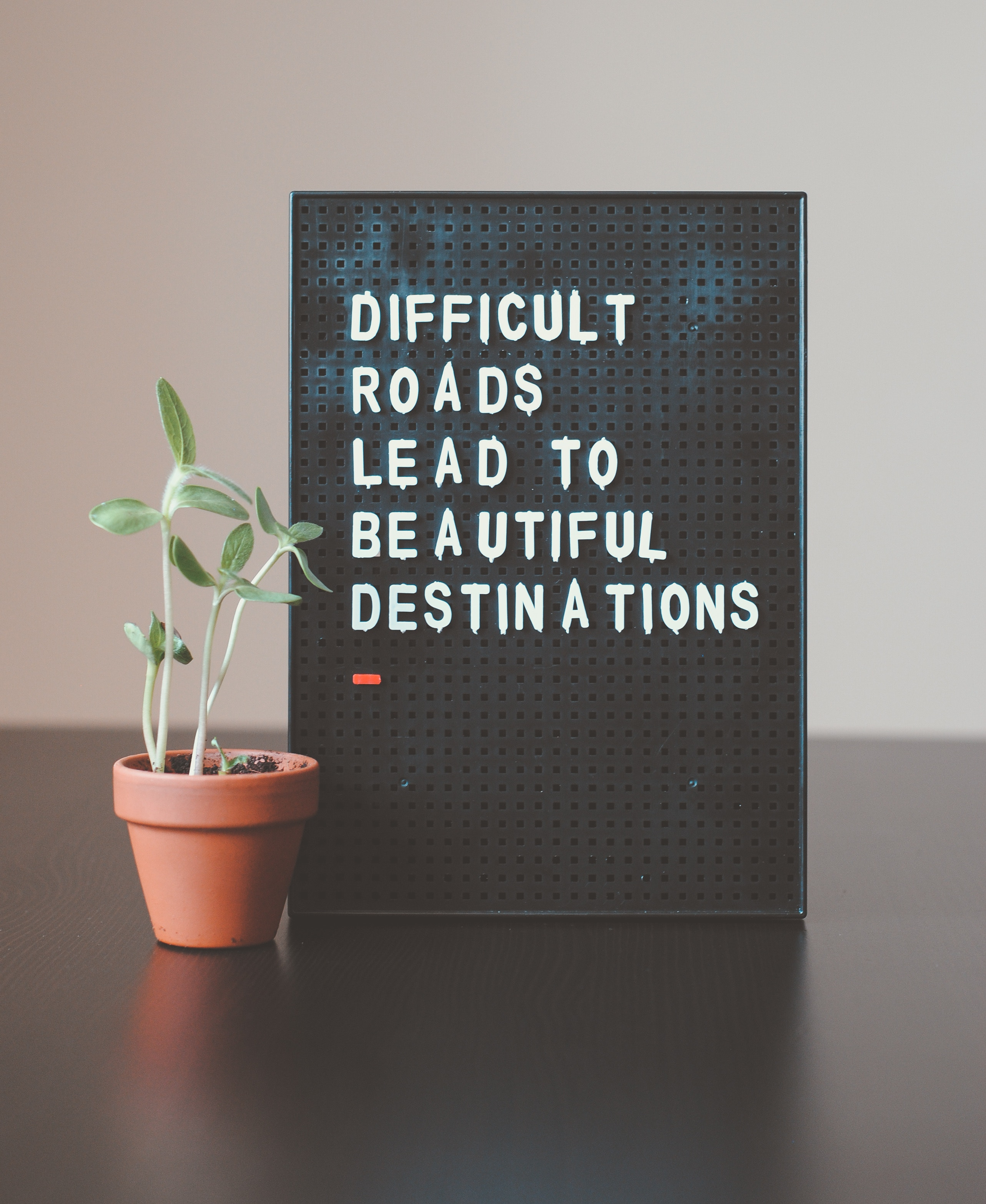 A sign that says difficult roads lead to beautiful destinations.