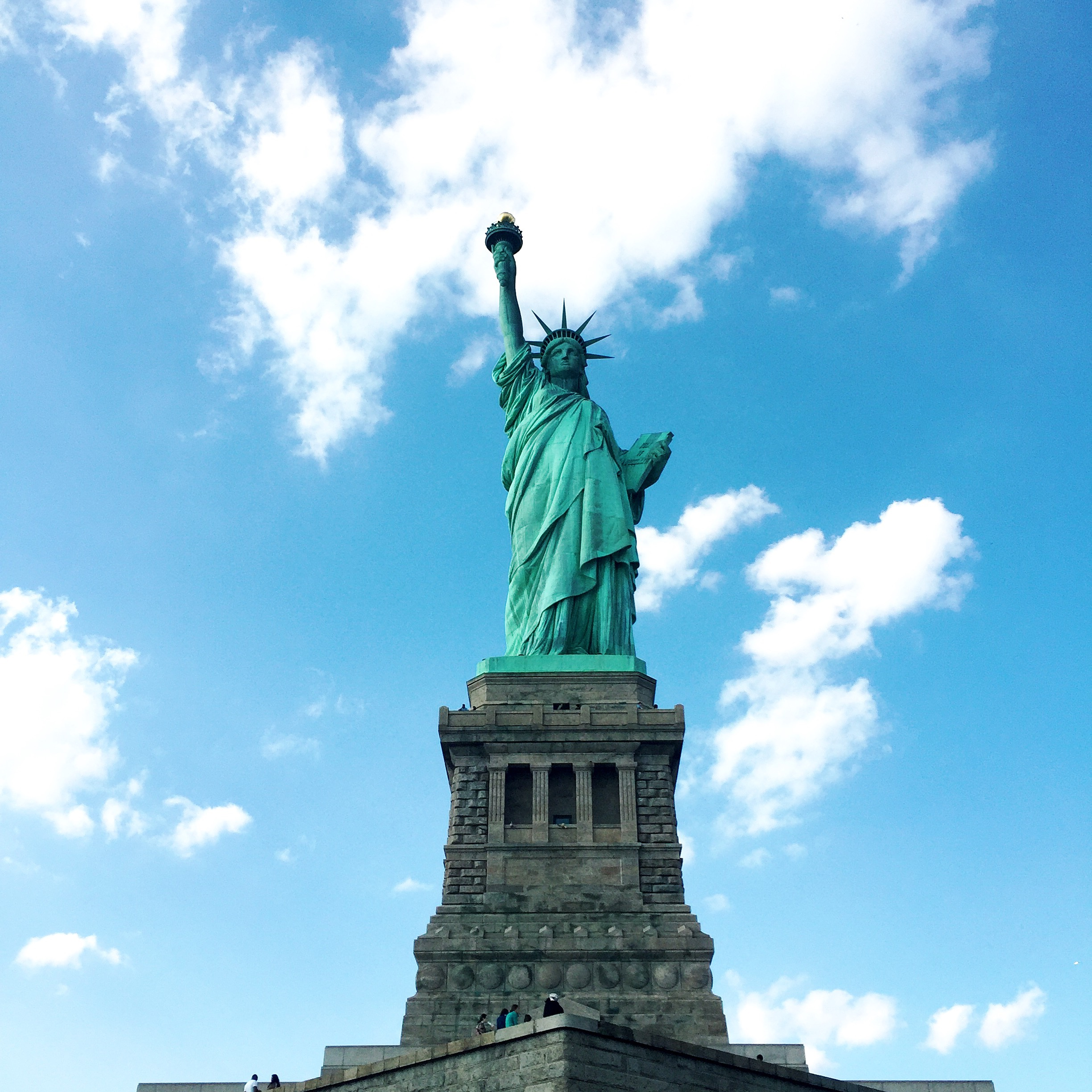 The Statue of Liberty against a blue sky